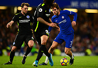 Marcos Alonso of Chelsea takes on Dale Stephans of Brighton during the EPL - Premier League match between Chelsea and Brighton and Hove Albion at Stamford Bridge, London, England on 26 December 2017. Photo by PRiME Media Images.