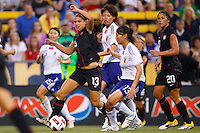 14 MAY 2011: USA Women's National Team forward Alex Morgan (13)  dribbles past Japan National team Rumi Utsugi during the International Friendly soccer match between Japan WNT vs USA WNT at Crew Stadium in Columbus, Ohio.