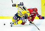 Huddinge 2015-09-20 Ishockey Division 1 Huddinge Hockey - S&ouml;dert&auml;lje SK :  <br /> S&ouml;dert&auml;ljes Anton Holm i kamp om pucken med Huddinges  Martin Eklund under matchen mellan Huddinge Hockey och S&ouml;dert&auml;lje SK <br /> (Foto: Kenta J&ouml;nsson) Nyckelord:  Ishockey Hockey Division 1 Hockeyettan Bj&ouml;rk&auml;ngshallen Huddinge S&ouml;dert&auml;lje SK SSK