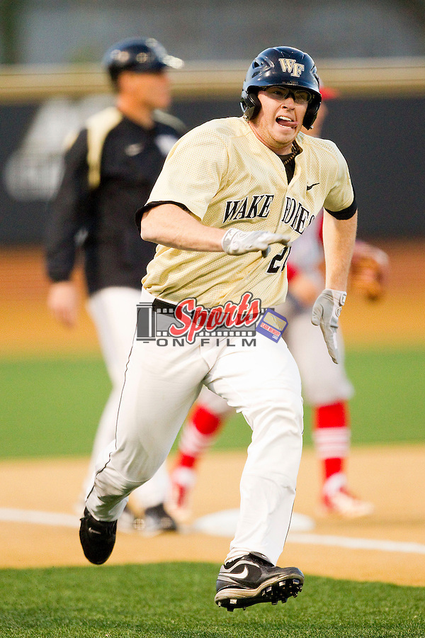 Jack Carey (20) of the Wake Forest Demon Deacons rounds third base against the North Carolina State Wolfpack at Wake Forest Baseball Park on March 15, 2013 in Winston-Salem, North Carolina.  The Wolfpack defeated the Demon Deacons 12-6.  (Brian Westerholt/Sports On Film)