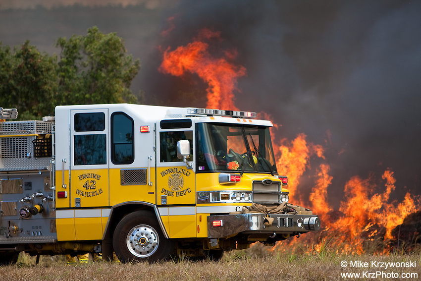 Fire engine next to brush fire in Waiala, Oahu, Hawaii