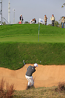 Branden Grace (RSA) chips from a bunker at the 16th green during Sunday's Final Round of the 2014 BMW Masters held at Lake Malaren, Shanghai, China. 2nd November 2014.<br /> Picture: Eoin Clarke www.golffile.ie