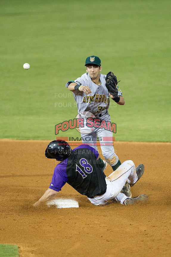 Adam Engel (18) of the Winston-Salem Dash slides into second baseman David Nick (38) of the Lynchburg Hillcats to break up a double play in the bottom of the 9th inning at BB&T Ballpark on August 13, 2014 in Winston-Salem, North Carolina.  The Hillcats defeated the Dash 4-3.   (Brian Westerholt/Four Seam Images)