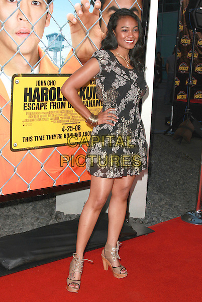 "TATIANA ALI.""Harold and Kumar Escape From Guantanamo Bay"" Los Angeles Premiere held at the ArcLight Cinerama Dome Theatre, Hollywood, California, USA, 17 April 2008..full length dress print hand on hip black buttons gold necklaces floral beige wooden heels shoes laces.CAP/ADM/`CH.©Charles Harris/Admedia/Capital PIctures"