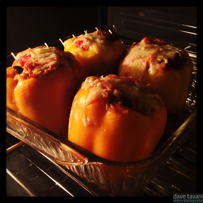 Vegetarian stuffed peppers cook in the oven on January 21, 2013.