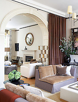The living room is joined by an archway in this large contemporary apartment
