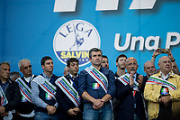 """Local politicians of Lega/League.<br /> <br /> Rome, 19/10/2019. Today, tens thousands of people (200,000 for the organisers, 50,000 for the police) gathered in Piazza San Giovanni to attend the national demonstration """"Orgoglio Italiano"""" (Italian Pride) of the far-right party Lega (League) of Matteo Salvini. The demonstration was supported by Silvio Berlusconi's party Forza Italia and Giorgia Meloni's party Fratelli d'Italia (Brothers of Italy, right-wing).  <br /> The aim of the rally was to protest against the Italian coalition Government (AKA Governo Conte II, Conte's Second Government, Governo Giallo-Rosso, 1.) lead by Professor Giuseppe Conte. The 66th Government of Italy is a coalition between Five Star Movement (M5S, 2.), Democratic Party (PD – Center Left, 3.), and Liberi e Uguali (LeU – Left, 4.), these last two parties replaced Lega / League as new members of a coalition based on Parliamentarian majority as stated in the Italian Constitution. The Governo Conte I (Conte's First Government, 5.) was 14-month-old when, between 8 and 9 of August 2019, collapsed after the Interior Minister Matteo Salvini withdrew his euroskeptic, anti-migrant, right-wing Lega / League (6.) from the populist coalition in a pindaric attempt (miserably failed) to trigger a snap election.<br /> <br /> Footnotes & Links:<br /> 1. http://bit.do/feK6N<br /> 2. http://bit.do/e7JLx<br /> 3. http://bit.do/e7JKy<br /> 4. http://bit.do/e7JMP<br /> 5. http://bit.do/e7JH7<br /> 6. http://bit.do/eE7Ey<br /> https://www.leganord.org<br /> http://bit.do/feK9X (Source, TheGuardian.com)<br /> Reportage: """"La Fabbrica Della Paura"""" (The Factory of Fear): http://bit.do/feLcy (Source Report, Rai.it - ITA)<br /> (Update) Reportage: """"La Fabbrica Social Della Paura"""" (The Social Network Factory of Fear): http://bit.do/fe8Pn (Source Report, Rai.it - ITA)"""