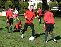 USWNT defender Becky Sauerbrunn demonstrates a drill during a Lets Move! soccer clinic held on the South Lawn of the White House.  Let's Move! was started by Mrs. Obama as a way to promote a healthier lifestyle in children across the country.