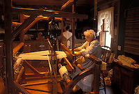 OH, Ohio, Archbold, Woman works on a loom inside Barbara's Weaving Shop at the Historic Sauder Farm and Craft Village.
