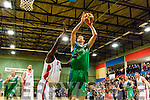 Garvey's  Tralee Warriors,Dusan Bogdanovic uses all his 6ft 11 to rise over Templeogues Mike Bonaparte to score for his side last Saturday night at Tralee sports complex.