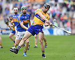 John Conlon of Clare in action against Noel Mc Grath of Tipperary during their quarter final at Pairc Ui Chaoimh. Photograph by John Kelly.