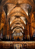 High vaulted Gothic ceiling with tiered arches to the either side, screen in the foreground and apse in the distance, pictured on February 8, 2011 in the Cathedral of the Holy Cross and Saint Eulalia, 1298 - 1450, in Barcelona, Catalonia, Spain. Picture by Manuel Cohen