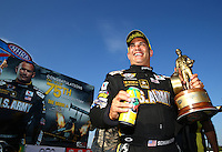 Sep 20, 2014; Ennis, TX, USA; NHRA top fuel driver Tony Schumacher celebrates after winning the rescheduled Carolina Nationals as a part of qualifying for the Fall Nationals at the Texas Motorplex. The race was originally scheduled at zMax Dragway in Concord, NC but was moved due to track conditions. The win was the 75th of Schumachers career, a top fuel record. Mandatory Credit: Mark J. Rebilas-USA TODAY Sports