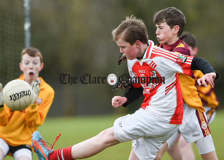 Luke Talty of Kilmurry Mc Mahon is tackled by Tulla's Jimmy O Gorman at the INTO Boys Mini-Sevens schools football finals at Eire Og pitch, Ennis. Photograph by John Kelly.