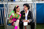 © Joel Goodman - 07973 332324. 05/08/2017 . Macclesfield , UK . A man dressed as Adam Ant eats a burger at the Rewind Festival , celebrating 1980s music and culture , at Capesthorne Hall in Siddington . Photo credit : Joel Goodman