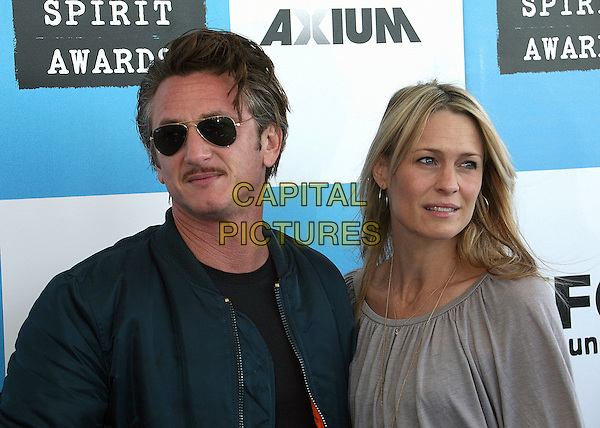 SEAN PENN & ROBIN WRIGHT PENN.2007 Film Independent's Spirit Awards at the Santa Monica Pier, Santa Monica, California, USA,.24 February 2007..portrait headshot sunglasses married husband wife.CAP/ADM/BP.©Byron Purvis/AdMedia/Capital Pictures.