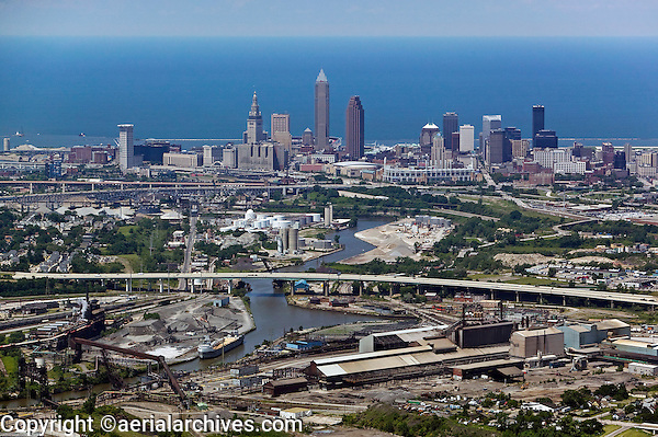 aerial view above Cleveland Ohio skyline industrial area steel mills Cuyahoga river Lake Erie