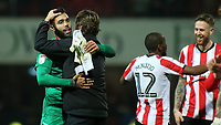 Brentford Head Coach, Thomas Frank, celebrates their victory with goalkeeper, David Raya at the final whistle during Brentford vs Reading, Sky Bet EFL Championship Football at Griffin Park on 23rd November 2019