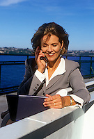 Businesswoman works and commutes by ferry.