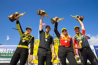 May 6, 2018; Commerce, GA, USA; (From left) NHRA top fuel driver Leah Pritchett , pro stock driver Vincent Nobile m, funny car driver Courtney Force and pro stock motorcycle rider Eddie Krawiec celebrate after winning the Southern Nationals at Atlanta Dragway. Mandatory Credit: Mark J. Rebilas-USA TODAY Sports