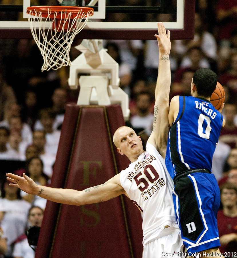 TALLAHASSEE, FLA. 2/23/12-FSU-DUKE022312 CH-FSU's Jon Kreft can't keep Austin Rivers from shoot during second half action Feb. 23, 2012 in Tallahassee. The Blue Devils beat the Seminoles 74-66..COLIN HACKLEY PHOTO