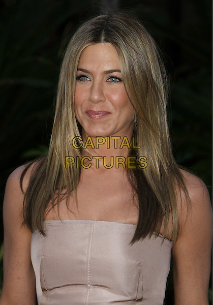 "JENNIFER ANISTON.""The Switch"" Los Angeles Premiere held at Arclight Cinemas, Hollywood, California, USA..August 16th, 2010.half length strapless beige nude lips mouth funny face smiling.CAP/ADM/CH.©Charles Harris/AdMedia/Capital Pictures"