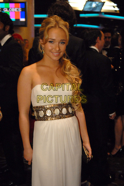 "HAYDEN PANETTIERE.Telecast - 64th Annual Golden Globe Awards, Beverly Hills HIlton, Beverly Hills, California, USA..January 15th 2007. .globes half length white strapless dress gold belt.CAP/AW.Please use accompanying story.Supplied by Capital Pictures.© HFPA"" and ""64th Golden Globe Awards"""