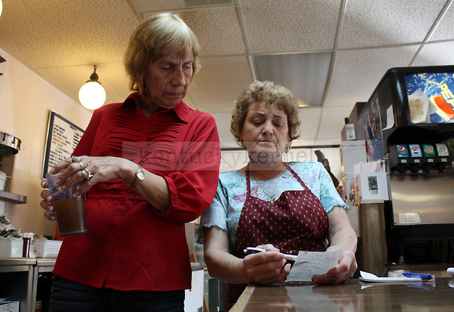 Sylvia _____ asks Nina Million to look over a customer's order. Million also works as a waitress in the restaurant since she is short on staff. Photo by Grace Profancik