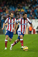 Atletico de Madrid´s Arda Turan and Juanfran during 2014-15 La Liga match between Atletico de Madrid and Villarreal at Vicente Calderon stadium in Madrid, Spain. December 14, 2014. (ALTERPHOTOS/Luis Fernandez) /NortePhoto