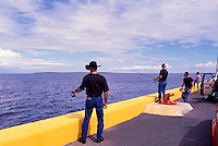 Caraquet, NB, New Brunswick, Canada - Fishermen fishing from Pier at Port du Caraquet