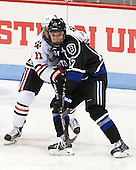 Jake Schechter (NU - 11), Jake Ahlgren (Bentley - 17) - The visiting Bentley University Falcons defeated the Northeastern University Huskies 3-2 on Friday, October 16, 2015, at Matthews Arena in Boston, Massachusetts.