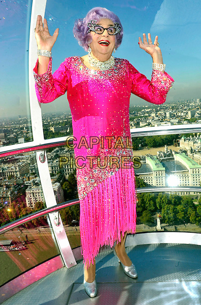 Barry Humphries aka Dame Edna Everage.Photocall for New Wimbledon Theatre's 2011 Pantomime 'Dick Whittington' held on the London Eye, London, England..September 29th 2011.panto pantomime full length costume pink dress glasses purple rinse wig hands arms sequins sequined   .CAP/JIL.©Jill Mayhew/Capital Pictures