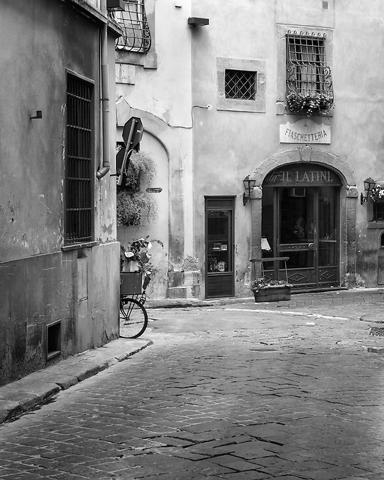 A glimpse around the corner of the historic streets of Florence, Italy.