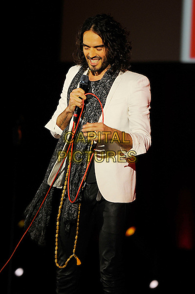 Russell Brand performing his 'Messiah Complex' Show, Eventim Apollo, Hammersmith, London, England. <br /> 14th October 2013<br /> on stage in concert live gig performance half length white suit jacket grey gray scarf beard facial hair <br /> CAP/MAR<br /> &copy; Martin Harris/Capital Pictures