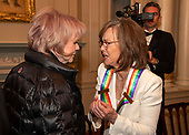 Singer Linda Ronstadt, left, and actress Sally Field, two of the recipients of the 42nd Annual Kennedy Center Honors converse after posing for a group photo following a dinner at the United States Department of State in Washington, D.C.  The 2019 honorees are: Earth, Wind & Fire, Sally Field, Linda Ronstadt, Sesame Street, and Michael Tilson Thomas.<br /> Credit: Ron Sachs / Pool via CNP