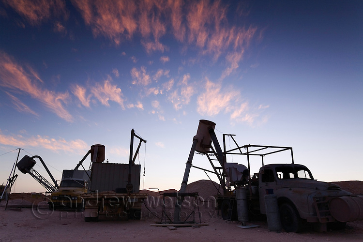Blowers (trucks used to extract dirt from underground opal mines) and other mining equipment in the Coober Pedy opal fields.  Coober Pedy, South Australia, AUSTRALIA.
