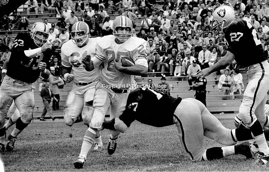 Oakland Raiders vs Houston Oilers playing at Frank Youell field in downtown Oakland..Ode Burrell and Bob Talamini, and Raiders Dan Birdwell,and Ike Lassiter...(1964)<br />