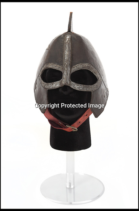 BNPS.co.uk (01202) 558833<br /> Picture: Julien's/BNPS<br /> <br /> ****Please use full byline****<br /> <br /> Rohirrim leather helmet estimated to fetch &pound;7,500.<br /> <br /> Lord of the bling...<br /> <br /> Hobbit hero Frodo Baggins' ring and sword are among an incredible &pound;1.5 million archive of props from the blockbuster Lord of the Rings films that has emerged for sale.<br /> <br /> Dozens of the smash hit trilogy's most iconic costumes and props are up for grabs including Gandalf's staff, Sauron's helmet and Gimli's battle axe.<br /> <br /> Fans of the films, adapted from the 1954 book by British author J.R.R. Tolkein, can also get their hands on prosthetic hobbit ears and feet.<br /> <br /> Amazingly the props have been compiled by a Lord of the Rings enthusiast who has spent more than 10 years scouring the world for authentic memorabilia.<br /> <br /> They are being sold by Julien's Auctions in Los Angeles on December 5.