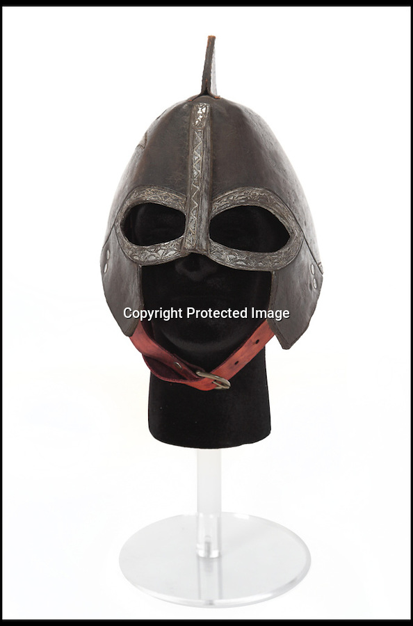 BNPS.co.uk (01202) 558833<br /> Picture: Julien's/BNPS<br /> <br /> ****Please use full byline****<br /> <br /> Rohirrim leather helmet estimated to fetch £7,500.<br /> <br /> Lord of the bling...<br /> <br /> Hobbit hero Frodo Baggins' ring and sword are among an incredible £1.5 million archive of props from the blockbuster Lord of the Rings films that has emerged for sale.<br /> <br /> Dozens of the smash hit trilogy's most iconic costumes and props are up for grabs including Gandalf's staff, Sauron's helmet and Gimli's battle axe.<br /> <br /> Fans of the films, adapted from the 1954 book by British author J.R.R. Tolkein, can also get their hands on prosthetic hobbit ears and feet.<br /> <br /> Amazingly the props have been compiled by a Lord of the Rings enthusiast who has spent more than 10 years scouring the world for authentic memorabilia.<br /> <br /> They are being sold by Julien's Auctions in Los Angeles on December 5.