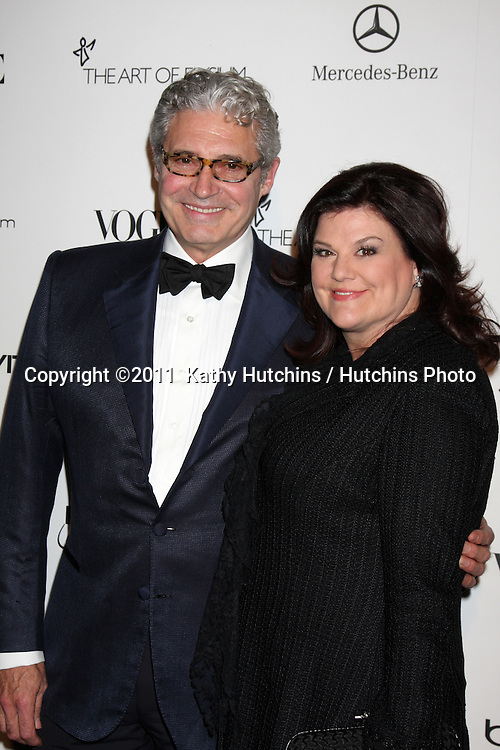 LOS ANGELES - JAN 15:  Michael Nouri, Ann Serrano Lopez  arrives at the Art Of Elysium 'Heaven' Gala 2011 at The California Science Center Exposition Park  on January 15, 2011 in Los Angeles, CA