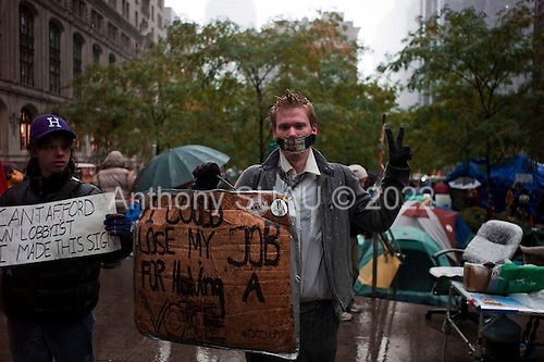New York, New York<br /> October 29, 2011<br /> <br /> The first snow and cold weather hit the &quot;Occupy Wall Street&quot; protesters in Zuccutti Park. <br /> <br /> &quot;Occupy Wall Street&quot; in Zuccutti Park is a movement against economic inequality, which began on September 17, 2011 and sparked protests nationwide and globally.