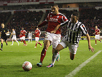 Josh Magennis (left) and Dougie Imrie go for the ball in the Aberdeen v St Mirren Scottish Communities League Cup match played at Pittodrie Stadium, Aberdeen on 30.10.12.