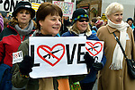"Denise deGabriele and other members of First United Methodist Church of Seattle were among hundreds of Seattle residents who marched from Westlake Center Park to the Seattle Center on January 13, 2013, calling for stricter regulations of firearms. Sponsored by a network of churches and other groups called ""Stand-up Washington,"" the demonstrators called for a state ban on semi-automatic weapons as well as stricter gun laws."