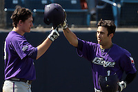 Davy Wright #3 of the TCU Horned Frogs greets teammate Kyle Von Tungeln #1 during a game against the Cal State Fullerton Titans at Goodwin Field on February 26, 2012 in Fullerton,California. Fullerton defeated TCU 11-10.(Larry Goren/Four Seam Images)