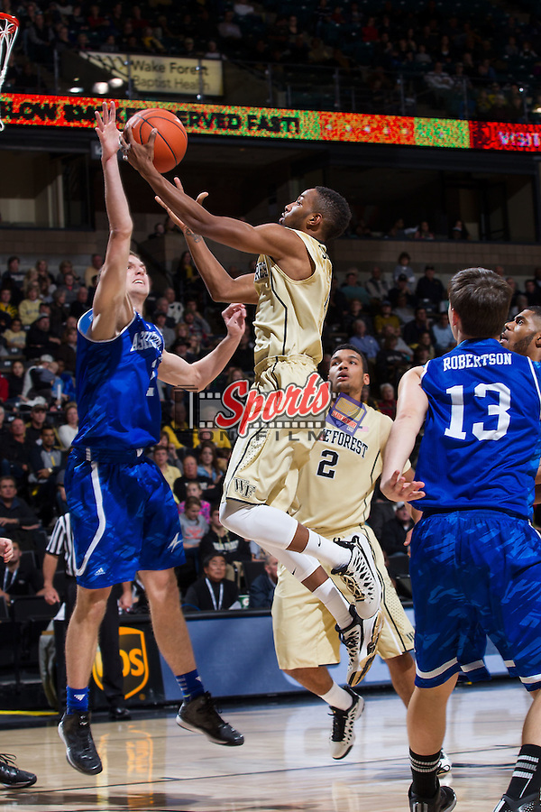 Codi Miller-McIntyre (0) of the Wake Forest Demon Deacons drives to the basket during first half action against the UNC Asheville Bulldogs at the LJVM Coliseum on November 14, 2014 in Winston-Salem, North Carolina.  The Demon Deacons defeated the Bulldogs 80-69  (Brian Westerholt/Sports On Film)