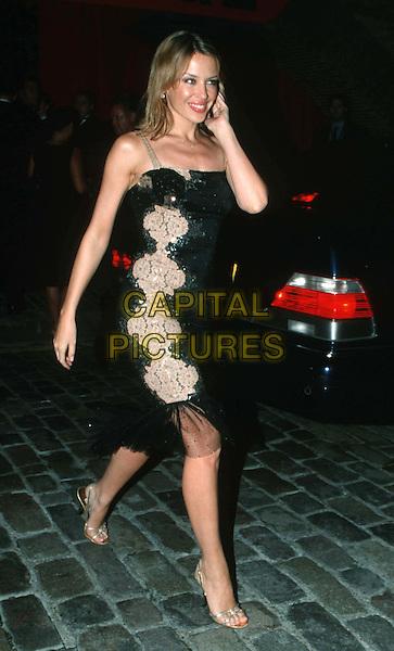 KYLIE MINOGUE..Ref: 11028..black dress..www.capitalpictures.com..sales@capitalpictures.com..©Capital Pictures..full length, full-length