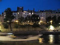 Tour boat passes classic Parisian townhouses