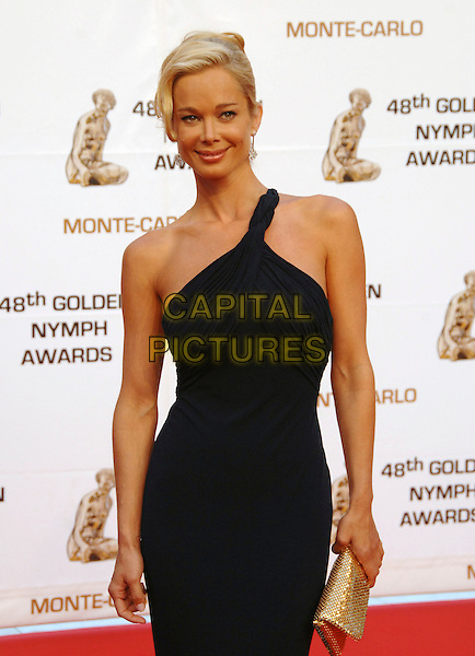 JENNIFER GAREIS.At the Golden Nymph awards ceremony during the 2008 Monte Carlo Television Festival held at Grimaldi Forum, Monte Carlo, Principality of Monaco, .June 12, 2008..half length grecian one shoulder black gold clutch bag dress.CAP/TTL .©TTL/Capital Pictures