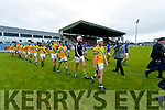 The teams parade before the Kerry County Senior Hurling championship Final between Kilmoyley and Lixnaw at Austin Stack Park on Sunday.