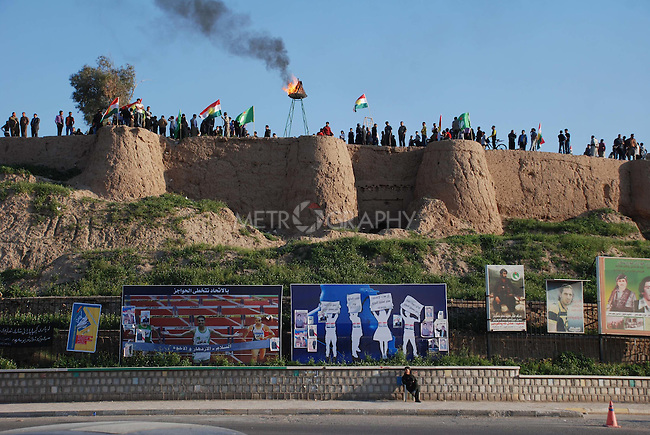 KIRKUK, IRAQ:  Kurds from Kirkuk gather at the city's citadel to celebrate Newroz...Newroz, celebrated across the world on the vernal equinox, is the official beginning of the Kurdish calendar and the first day of spring.  Kurds celebrate Newroz on March 20th and 21st by lighting fires and performing traditional dances...Photo by Hawre Khalid/ Metrography